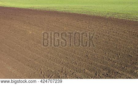 Freshly Plowed Field As Background Or Backdrop