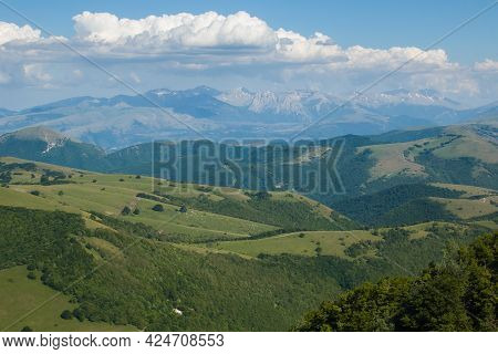 Panoramic View Of The Chain Of Monti Sibillini In The Marche Region During Spring Day Of Sunny