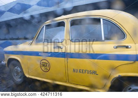 Raindrops Falling On Glass, Abstract Blurs - Monsoon Stock Image Of Traditional Yellow Taxi Of Kolka