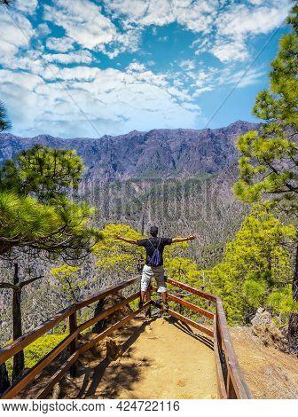 A Young Tourist At The Mirador Lomo De Las Chozas De La Cumbrecita On The Island Of La Palma Next To