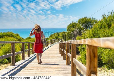 A Young Girl On The Wooden Path To Playa Moncayo In Guardamar Del Segura Next To Torrevieja, Alicant