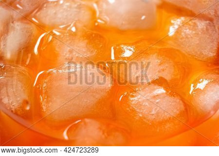 Ice Cubes Melt In Glass With Aperol Spriz Cocktail, Close Up