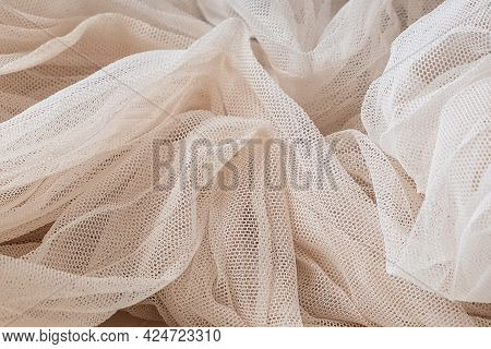 Close-up Texture Of Crumpled Ivory Tulle Fabric, Background