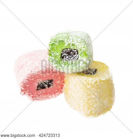 Pile Of Delicious Colorful Chewing Candies On White Background
