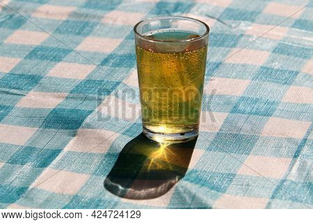A Glass Of Light Beer On The Table In A Beer Pub