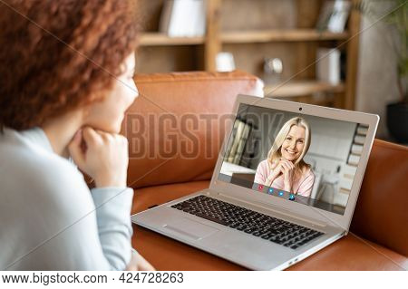 Grown Daughter Talk Via Video Call On The Laptop With A Senior Mother, Lying On The Couch And Looks