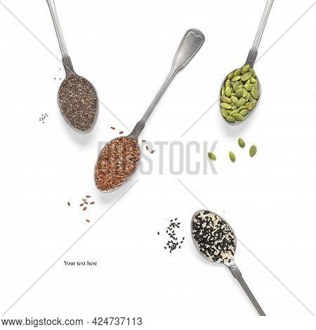 Set Of Various Seeds In Spoons Isolated On White Background. Pumpkin, Flax, Sesame And Chia Seeds. C