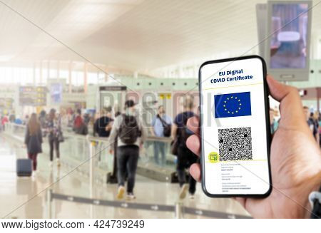 Eu Digital Covid Certificate With The Qr Code On The Screen Of A Mobile Held By A Hand With Blurred
