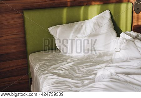 On A Bed In Bedroom The Rays Of The Sun Fall. Comfortable Bed With White Linen At Home