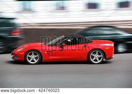 Kiev, Ukraine - May 22, 2021: American Muscle Car Chevrolet Corvette Convertible In Motion. Blurred