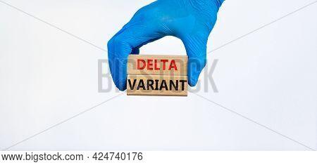 Covid-19 New Delta Variant Strain Symbol. Hand In Blue Glove Holds Wooden Blocks Words 'delta Varian