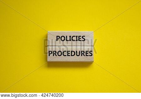 Policies And Procedures Symbol. Wooden Blocks With Concept Words Policies Procedures On Yellow Backg