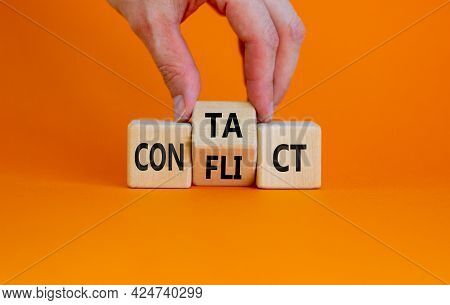 Conflict Or Contact Symbol. Businessman Turns The Wooden Cube And Changes The Word 'conflict' To 'co