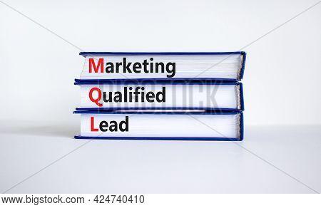 Mql Marketing Qualified Lead Symbol. Books With Words 'mql Marketing Qualified Lead'. Beautiful Whit