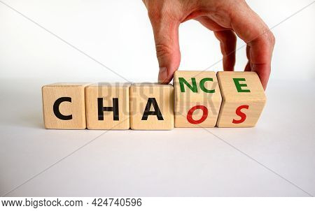 Chance Or Chaos Symbol. Businessman Turns Wooden Cubes And Changes The Word 'chaos' To 'chance'. Bea