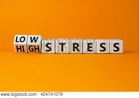 Low Or High Stress Level Symbol. Turned Wooden Cubes And Changed Words High Stress To Low Stress. Be