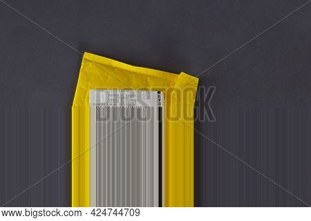 A Yellow Mail Bag That Says Return To Sender. Undelivered Package On A Gray Background. Top View, No