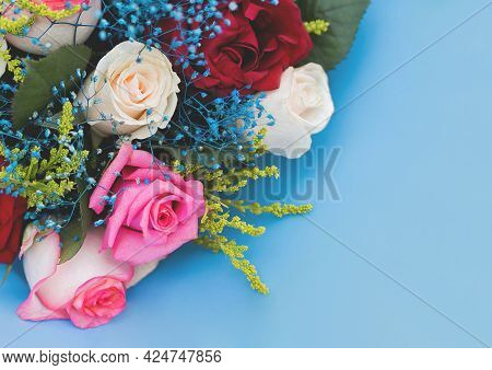 Decorative Wedding Bouquet Of Roses Flowers On A Blue Background.