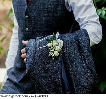 Groom In The Wedding Suit. Handsome Groom Preparing For The Wedding