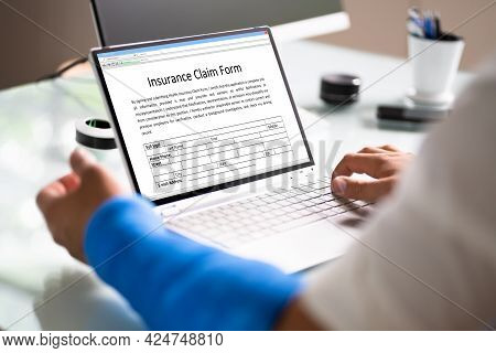 Broken Arm Injured Worker Compensation Coverage. Using Office Laptop
