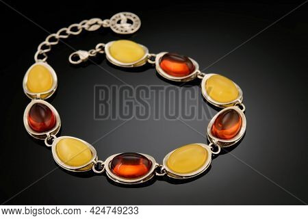 Variously Sized Bracelet Made Of Natural Polished Transparent Honey Luxury Amber Beads With Inclusio