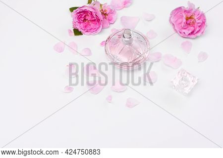 Perfumery. Eau De Toilette Or Women's Perfume With The Scent Of Flowers. On A White Background. Top