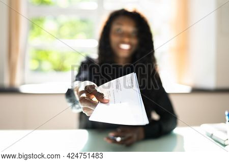 African Business Woman Giving Paycheck Or Payroll Cheque