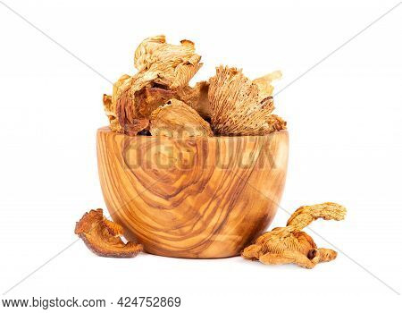 Dried Chanterelle Mushrooms In Olive Bowl, Isolated On White Background. Dried Forest Chanterelle Mu
