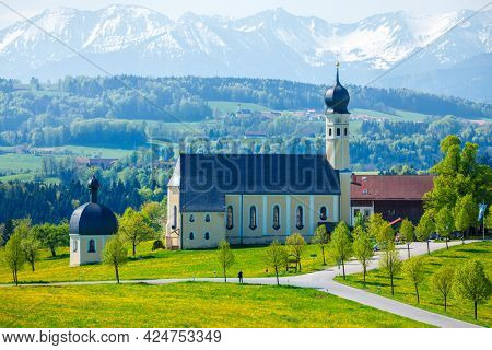 Biew of Bavaria countryside rural scene - Pilgrimage church of Wilparting, Irschenberg village, Upper Bavaria, Germany