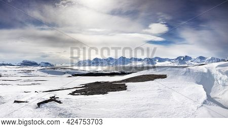 Panoramic view of the mountains, snow and fjords of Svalbard in the Arctic Circle, a Norwegian archipelago between mainland Norway and the North Pole