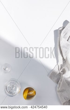 Top view of restaurant or cafe table with white tablecloth. Empty cafe table with sunshine and harsh shadow view from above. Summer day at cafe concept. Crystal white background