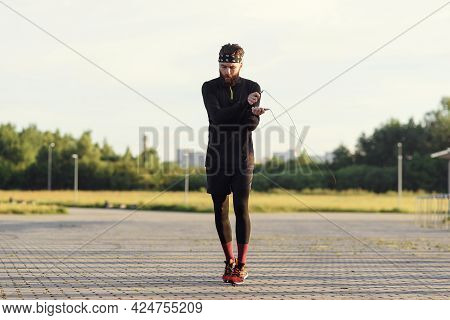 Fitness Sports Man Jumping With Skipping Rope Outdoors.