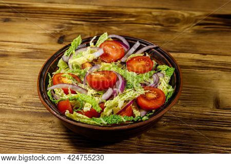 Healthy Salad With Savoy Cabbage, Cherry Tomato, Red Onion And Olive Oil On Wooden Table