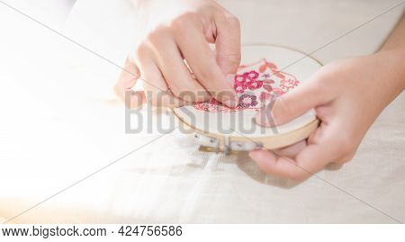 Female Hand Holding Wood Embroidery Frame And And Needle Working On Pattern Stitching In A Process O