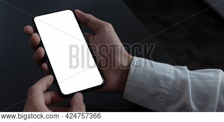 Mockup Image Blank White Screen Cell Phone.women Hand Holding Texting Using Mobile On Desk At Home O