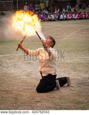 Lamphun, Thailand - April 12, 2019: Female Perform Fire Breathing On Songkran Festival In Lamphun Pr