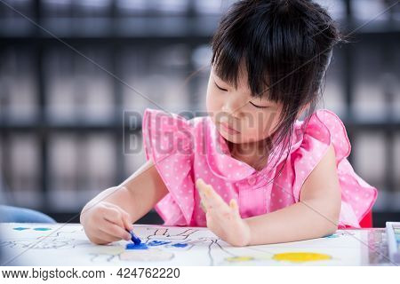 Pupil Kid Learning Art On White Paper With Chalk Color. Study At Home. Asian Child Doing Crafting On