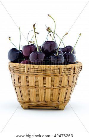 Sweet Black Cherries In A Wood Basket