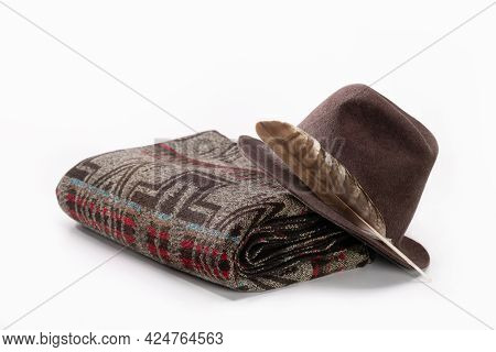 Christmas Gift, Woolen Throw Blanket In Pendelton Style And Hat With Feather On White Background.
