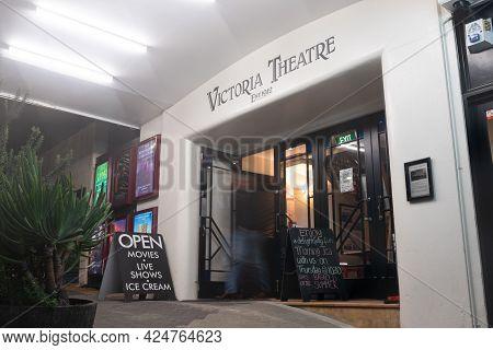 Auckland New Zealand -june 16 2021; Night Scene Of Building Entrance Under Veranda And Street Scene