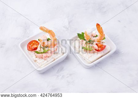Delicious Shrimp Canapes With Tomato And Arugula On A Light Background. Festive Appetizer With Seafo