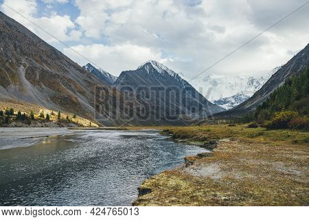 Scenic Autumn Landscape With Mountain Lake In Sunlit Golden Valley With View To Big Rock With Snow O