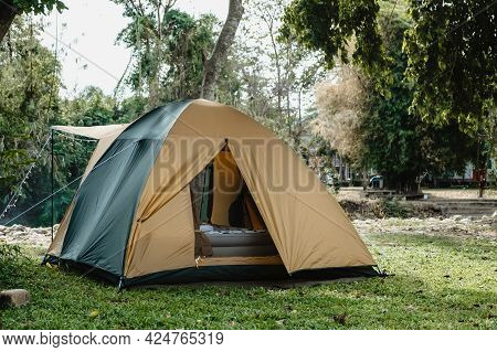 Camping Picnic Green Tent Campground In Outdoor Hiking Forest.  Camper While Campsite In Nature Back