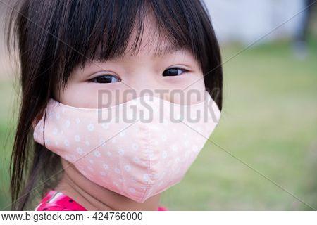 Child Wearing Cloth Face Mask To Prevent Spread Coronavirus (covid-19) Disease. Closeup Face Girl. I