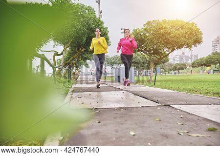 Multiethnic Women Jogging On The Street, Jogging In City In Dusk