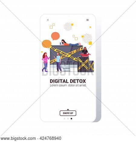 People Near Gadgets With Keep Away Yellow Tape Digital Detox Rest From Devices Concept