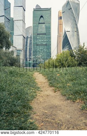 Path Among The Grass Leading To The Business City