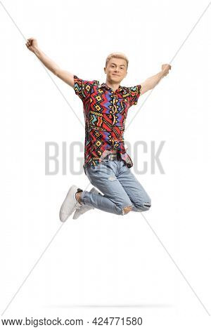 Excited guy with bleached hair and a colorful t-shirt jumping isolated on white background