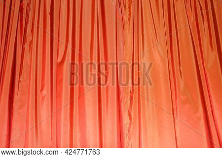 Orange Draped Curtains Close-up Texture For Textile Background