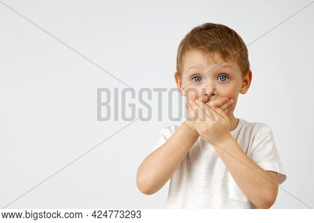 Child Restrains Emotion By Covering His Mouth With His Hands, So As Not To Cry Out From The Horror T